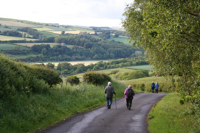 Walkers descending into the Tyne Valley